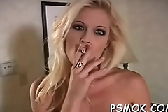 Horny cuttie in lustful raiment smoking a cigarette