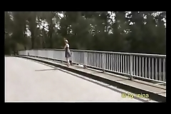 Nina flashing on a bridge